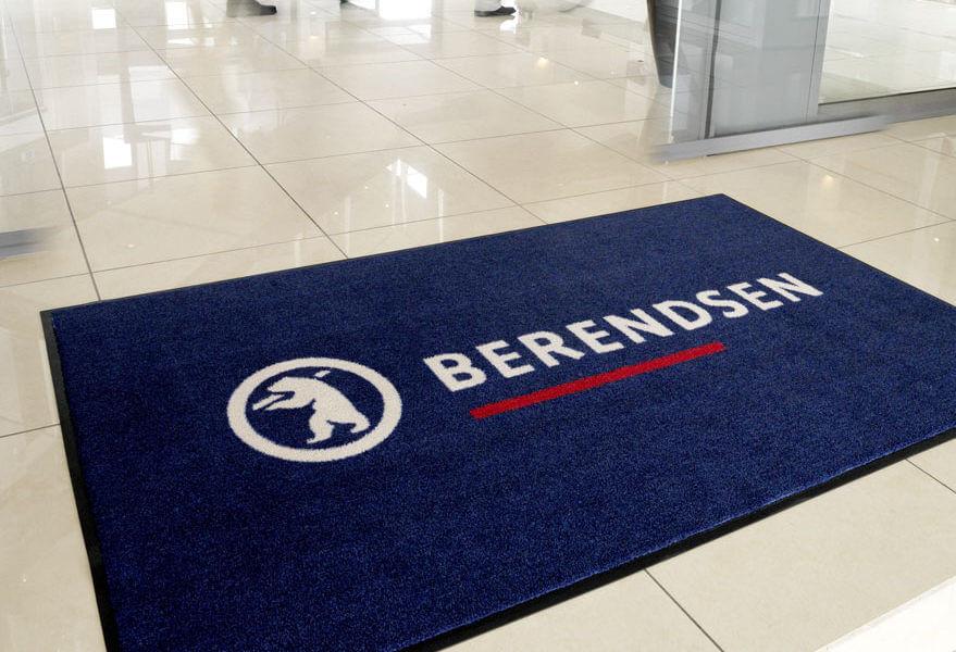 Het Berendsen logo afgebeeld op een mat